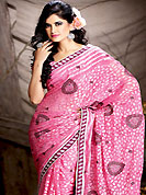 The evolution of style species collection spells pure femininity. This pink brasso saree is nicely designed with embroidered patch work is done with resham and stone work. This saree gives you a modern and different look in fabulous style. Matching blouse is available with this saree. This saree is also available in A Light Purple, B Light Green colors. Slight color variations are possible due to differing screen and photograph resolution.