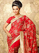 Elegance and innovation of designs crafted for you. This red faux georgette saree is nicely designed with embroidered patch work is done with zari work. This saree gives you a modern and different look in fabulous style. Matching blouse is available with this saree. This saree is also available in A Deep Blue, B Purple, C Light Blue, D Deep Green colors. Slight color variations are possible due to differing screen and photograph resolution.