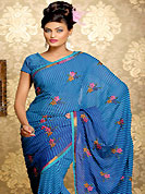 Ultimate collection of embroidered sarees with fabulous style. This blue faux georgette saree have beautiful stripe print and embroidery patch work which is embellished with resham work. Fabulous designed embroidery gives you an ethnic look and increasing your beauty. Matching blouse is available. This saree is also available in Purple color. Slight Color variations are possible due to differing screen and photograph resolutions.