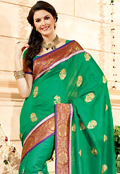 Try out this year top trend, glowing, bold and natural collection. This green faux georgette saree have beautiful embroidery patch work which is embellished with resham and zari work in floral motifs. Fabulous designed embroidery gives you an ethnic look and increasing your beauty. Matching blouse is available. Slight Color variations are possible due to differing screen and photograph resolutions.