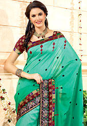 The traditional patterns used on this saree maintain the ethnic look. This green banarasi silk saree have beautiful embroidery patch work which is embellished with resham and self weaving zari work. Fabulous designed embroidery gives you an ethnic look and increasing your beauty. Contrasting maroon blouse is available. Slight Color variations are possible due to differing screen and photograph resolutions.