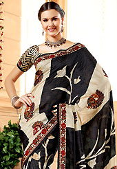 Take a look on the changing fashion of the season. This black and light fawn banarasi silk saree have beautiful embroidery patch work which is embellished with resham and stone work. Fabulous designed embroidery gives you an ethnic look and increasing your beauty. Matching blouse is available. Slight Color variations are possible due to differing screen and photograph resolutions.