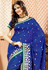 Get ready to sizzle all around you by sparkling saree. This dark blue banarasi silk saree have beautiful embroidery patch work which is embellished with zari work. Fabulous designed embroidery gives you an ethnic look and increasing your beauty. Matching blouse is available. Slight Color variations are possible due to differing screen and photograph resolutions.