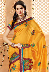 Your search for elegant look ends here with this lovely saree. This orange art silk saree have beautiful embroidery patch work which is embellished with resham and zari work. Fabulous designed embroidery gives you an ethnic look and increasing your beauty. Matching blouse is available. Slight Color variations are possible due to differing screen and photograph resolutions.