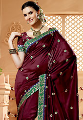 The evolution of style species collection spells pure femininity. This burgundy banarasi silk saree have beautiful embroidery patch work which is embellished with resham and zari work. Fabulous designed embroidery gives you an ethnic look and increasing your beauty. Matching blouse is available. Slight Color variations are possible due to differing screen and photograph resolutions.