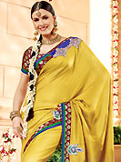 The glamorous silhouette to meet your most dire fashion needs. This golden yellow banarasi silk saree have beautiful embroidery patch work which is embellished with resham, zari and antique zardosi work. Fabulous designed embroidery gives you an ethnic look and increasing your beauty. Contrasting maroon blouse is available. Slight Color variations are possible due to differing screen and photograph resolutions.