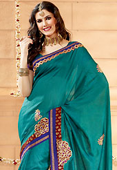 Breathtaking collection of sarees with stylish embroidery work and fabulous style. This teal green banarasi silk saree have beautiful embroidery patch work which is embellished with resham and zari work. Fabulous designed embroidery gives you an ethnic look and increasing your beauty. Matching blouse is available. Slight Color variations are possible due to differing screen and photograph resolutions.