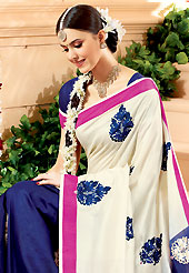 Welcome to the new era of Indian fashion wear. This off white and dark blue banarasi silk saree have beautiful embroidery patch work which is embellished with resham, zari and stone work. Fabulous designed embroidery gives you an ethnic look and increasing your beauty. Matching blouse is available. Slight Color variations are possible due to differing screen and photograph resolutions.