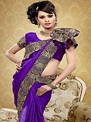The most beautiful refinements for style and tradition. This dark purple saree is nicely designed with embroidered patch work is done with resham, zari and sequins work. Saree gives you a singular and dissimilar look. Matching blouse is available. Slight color variations are possible due to differing screen and photograph resolution.