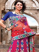Keep the interest with this designer embroidery saree. This shaded red and dark pink net lehenga style saree have beautiful embroidery patch work which is embellished with resham, zari, sequins and stone work. Fabulous designed embroidery gives you an ethnic look and increasing your beauty. Contrasting blue blouse is available. Slight Color variations are possible due to differing screen and photograph resolutions.