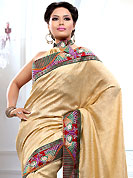 Breathtaking collection of sarees with stylish embroidery work and fabulous style. This light fawn bhagalpuri jacquard saree is nicely designed with embroidered patch work is done with resham, zari and sequins work. Saree gives you a singular and dissimilar look. Matching blouse is available. Slight color variations are possible due to differing screen and photograph resolution.