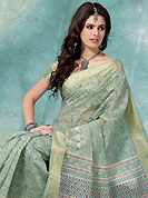 You can be sure that ethnic fashions selections of clothing are taken from the latest trend in today's fashion. This cream and teal cotton saree is nicely designed with floral, paisley print and self weaving work in fabulous style. This beautiful saree is used for casual porpose which gives you a singular and dissimilar look. Color blend of this saree is nice. Matching blouse is available with this saree. Slight Color variations are possible due to differing screen and photograph resolutions.