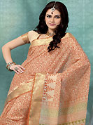 Dreamy variation on shape and forms compliment your style with tradition. This cream and orange cotton saree is nicely designed with floral, geometric print and self weaving work in fabulous style. This beautiful saree is used for casual porpose which gives you a singular and dissimilar look. Color blend of this saree is nice. Matching blouse is available with this saree. Slight Color variations are possible due to differing screen and photograph resolutions.