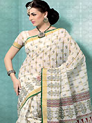 An endearing splash oh colors look gorgeous tridimensional charm. This off white and green cotton saree is nicely designed with floral and geometric print work in fabulous style. This beautiful saree is used for casual porpose which gives you a singular and dissimilar look. Color blend of this saree is nice. Matching blouse is available with this saree. Slight Color variations are possible due to differing screen and photograph resolutions.