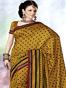 Exquisite combination of color, fabric can be seen here. This mustard art silk saree is nicely designed with dot, geometric print and self weaving work in fabulous style. This beautiful saree is used for casual porpose which gives you a singular and dissimilar look. Color blend of this saree is nice. Matching blouse is available with this saree. Slight Color variations are possible due to differing screen and photograph resolutions.