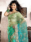 Dreamy variation on shape and forms compliment your style with tradition. This green and aqua blue net saree is nicely designed with embroidered patch work is done with cutdana, stone and cut border work. Embroidery work is highlighting the beauty of the saree. Saree gives you a singular and dissimilar look. Contrasting light grey blouse is available. Slight color variations are possible due to differing screen and photograph resolution.