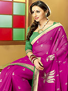 Let your personality articulate for you with this amazing embroidered saree. This magenta chiffon saree is nicely designed with flower print and patch border work. Saree gives you a singular and dissimilar look. Contrasting green blouse is available. Slight color variations are possible due to differing screen and photograph resolution.