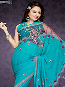 The most beautiful refinements for style and tradition. This sky blue faux chiffon and net saree is nicely designed with embroidered patch work is done with resham, sequins, stone and pearls work. This saree gives you a modern and different look in fabulous style. Matching blouse is available with this saree. Slight color variations are possible due to differing screen and photograph resolution.