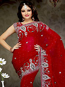 Ultimate collection of embroidery sarees with fabulous style. This red faux georgette saree is nicely designed with embroidered patch work is done with zari, sequins and stone work. This saree gives you a modern and different look in fabulous style. Matching blouse is available with this saree. Slight color variations are possible due to differing screen and photograph resolution.