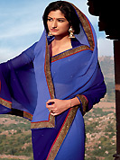 It is color this season and bright shaded suits are really something that is totally in vogue. This beautiful shaded blue saree is nicely designed with embroidery patch work is done with zari and stone work. It will enhance your personality and gives you a singular look. Matching blouse is available with this saree. Slight color variations are due to differing screen and photography resolution.