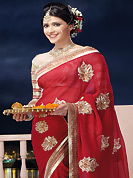 Make a trendy look with this classic embroidered saree. This red chiffon saree is nicely designed with embroidered and patch border work is done with zari and lace work. Saree gives you a singular and dissimilar look. Contrasting beige brocade blouse is available. Slight color variations are possible due to differing screen and photograph resolution.