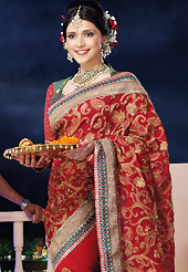 Breathtaking collection of sarees with stylish embroidery work and fabulous style. This red chiffon saree is nicely designed with embroidered and patch border work is done with zari, stone and lace work. Saree gives you a singular and dissimilar look. Contrasting green and red brocade blouse is available. Slight color variations are possible due to differing screen and photograph resolution.