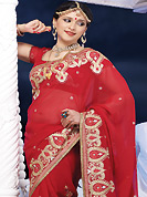 An endearing splash oh colors look gorgeous tridimensional charm. This red chiffon saree is nicely designed with embroidered and patch border work is done with resham, zari, stone and lace work. Saree gives you a singular and dissimilar look. Matching blouse is available. Slight color variations are possible due to differing screen and photograph resolution.