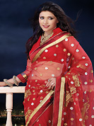 Elegance and innovation of designs crafted for you. This red net saree is nicely designed with embroidered and patch border work is done with zari, stone and lace work. Saree gives you a singular and dissimilar look. Matching blouse is available. Slight color variations are possible due to differing screen and photograph resolution.