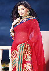 Keep the interest with this designer embroidery saree. This red chiffon saree is nicely designed with embroidered and patch border work is done with zari, stone and lace work. Saree gives you a singular and dissimilar look. Matching dupion blouse is available. Slight color variations are possible due to differing screen and photograph resolution.