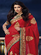Exquisite combination of color, fabric can be seen here. This dark red chiffon saree is nicely designed with embroidered and patch border work is done with zari, stone and lace work. Saree gives you a singular and dissimilar look. Matching blouse is available. Slight color variations are possible due to differing screen and photograph resolution.