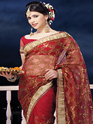 Take the fashion industry by storm in this beautiful embroidered saree. This red net saree is nicely designed with embroidered and patch border work is done with zari work. Saree gives you a singular and dissimilar look. Matching blouse is available. Slight color variations are possible due to differing screen and photograph resolution.