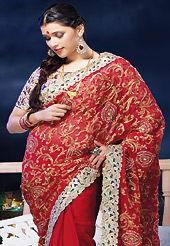 Ultimate collection of embroidered sarees with fabulous style. This red chiffon saree is nicely designed with embroidered and patch border work is done with zari and stone work. Saree gives you a singular and dissimilar look. Matching blouse is available. Slight color variations are possible due to differing screen and photograph resolution.