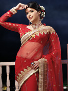 Outfit is a novel ways of getting yourself noticed. This red half half net and chiffon saree is nicely designed with embroidered and patch border work is done with zari, stone and lace work. Saree gives you a singular and dissimilar look. Matching viscose blouse is available. Slight color variations are possible due to differing screen and photograph resolution.