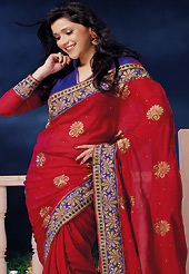 Style and trend will be at the peak of your beauty when you adorn this saree. This red chiffon saree is nicely designed with embroidered and patch border work is done with zari, stone and lace work. Saree gives you a singular and dissimilar look. Contrasting blue dupion and chiffon blouse is available. Slight color variations are possible due to differing screen and photograph resolution.