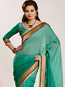 Keep the interest with this designer embroidery saree. This shaded green art silk saree have beautiful floral print and embroidery work which is embellished with zari, sequins and patch border work. This saree gives you a modern and different look in fabulous style. Matching blouse is available. Slight Color variations are possible due to differing screen and photograph resolutions.