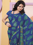 The most radiant carnival of style and beauty. This blue and sea green faux chiffon saree is nicely designed with abstract and leaf print work. Saree gives you a singular and dissimilar look. Matching blouse is available. Slight color variations are possible due to differing screen and photograph resolution.