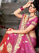 Make a trendy look with this classic embroidered saree. This pink and light red art silk saree have beautiful embroidery patch work which is embellished with resham, stone and lace work. This saree gives you a modern and different look in fabulous style. Matching blouse is available. Slight Color variations are possible due to differing screen and photograph resolutions.