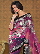 Let your personality articulate for you with this amazing embroidered saree. This pink and grey net saree have beautiful embroidery patch work which is embellished with zari, beads and stone work. Fabulous designed embroidery gives you an ethnic look and increasing your beauty. Matching blouse is available. Slight Color variations are possible due to differing screen and photograph resolutions.