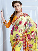 A desire that evokes a sense of belonging with a striking details. This shaded yellow and orange brasso faux georgette saree is nicely designed with floral, geometric print, lace and patch work. Saree gives you a singular and dissimilar look. Matching orange blouse is available. Slight color variations are possible due to differing screen and photograph resolution.