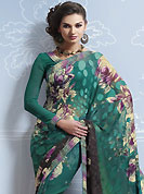 An occasion wear perfect is ready to rock you. This green and black brasso faux georgette saree is nicely designed with floral, geometric print, lace and patch work. Saree gives you a singular and dissimilar look. Matching blouse is available. Slight color variations are possible due to differing screen and photograph resolution.
