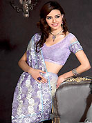 Take the fashion industry by storm in this beautiful embroidered saree. This off white and light purple net saree is nicely designed with embroidered patch work is done with resham, zari and sequins work. Saree gives you a singular and dissimilar look. Matching blouse is available. Slight color variations are possible due to differing screen and photograph resolution.