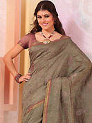 Style and trend will be at the peak of your beauty when you adorn this saree. This dark grey raw silk saree have beautiful embroidery patch work which is embellished with self weaving zari and resham work. Fabulous designed embroidery gives you an ethnic look and increasing your beauty. Matching blouse is available. Slight Color variations are possible due to differing screen and photograph resolutions.