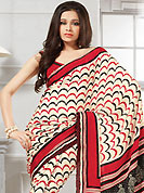 The fascinating beautiful subtly garment with lovely patterns. This cream, black and red georgette saree is nicely designed with abstract, geometric and wave like work. Saree gives you a singular and dissimilar look. Matching red blouse is available. Slight color variations are possible due to differing screen and photograph resolution.