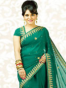 Elegance and honourable come together in this beautiful drape. Add a vibrant burst of color to your wardrobe with this green chiffon saree is nicely designed with embroidered patch work is done with beads, stones, gold zardosi and cutdana work. Saree gives you a singular and dissimilar look. Matching blouse is available. Slight color variations are possible due to differing screen and photograph resolution.