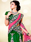 Breathtaking collection of sarees with stylish embroidery work and fabulous style. This pink, green and off white net lehenga style saree is nicely designed with embroidered patch work is done with resham, zari, stone, beads and cutbeads work. Saree gives you a singular and dissimilar look. Matching green blouse is available. Slight color variations are possible due to differing screen and photograph resolution.
