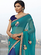 The fascinating beautiful subtly garment with lovely patterns. This light blue and dark blue faux georgette and net saree have beautiful embroidery patch work which is embellished with resham, zari and sequins work. This saree gives you a modern and different look in fabulous style. Matching dark blue blouse is available. Slight Color variations are possible due to differing screen and photograph resolutions.