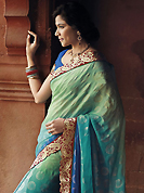 This season dazzle and shine in pure colors. This light green and shaded blue faux georgette saree have beautiful embroidery patch work which is embellished with zari work. This saree gives you a modern and different look in fabulous style. Matching blue blouse is available. Slight Color variations are possible due to differing screen and photograph resolutions.