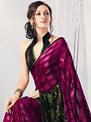 Try out this year top trend, glowing, bold and natural collection. This dark magenta, black and green brasso faux georgette saree is simply designed with floral and geometric print work. This beautiful saree is used for casual porpose which gives you a singular and dissimilar look. Color blend of this saree is nice. Matching blouse is available with this saree. Slight color variations possible due to differing screen and photograph resolution.