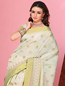 The most beautiful refinements for style and tradition. This beautiful off white and light green cotton saree is nicely designed with block print and self weaving zari work. Beautiful print work on saree make attractive to impress all. It will enhance your personality and gives you a singular look. Matching blouse is available with this saree. Slight color variations are due to differing screen and photography resolution.