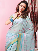 Printed sarees are the best choice for a girl to enhance her feminine look. This beautiful off white and light blue cotton saree is nicely designed with block print and self weaving zari work. Beautiful print work on saree make attractive to impress all. It will enhance your personality and gives you a singular look. Matching blouse is available with this saree. Slight color variations are due to differing screen and photography resolution.